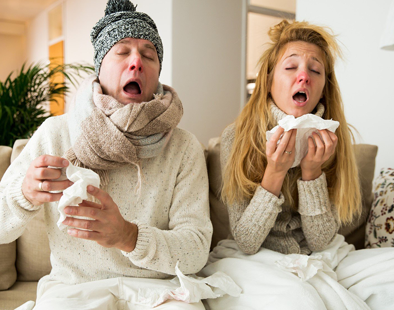 Man and woman with cold